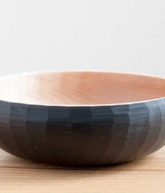 black faceted bowl