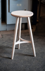 3 legged stool with curved stretchers front